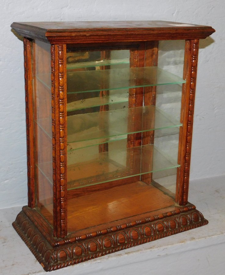 Small oak and glass display cabinet.
