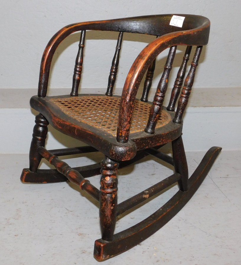 "Childs cane seat rocker. 17"" tall."