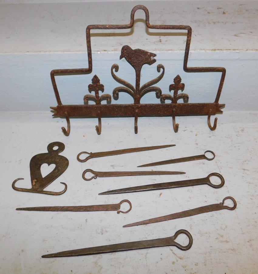Wrought iron pot rack & skewer holder w/ skewers.