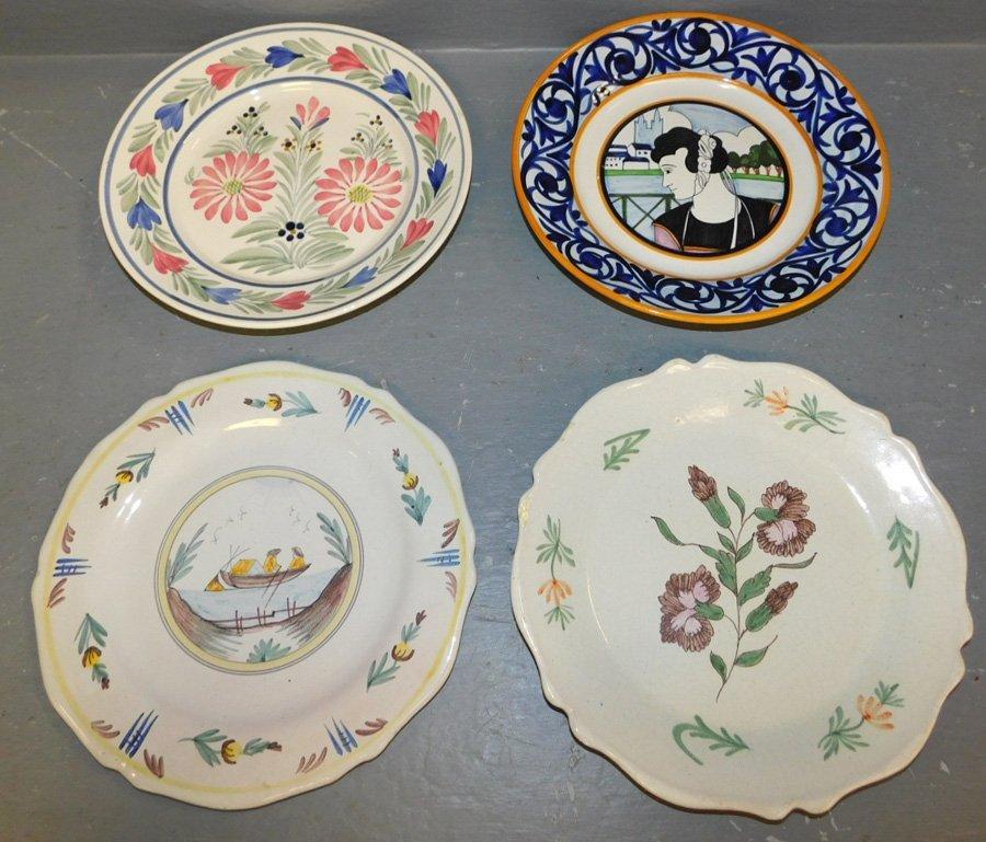 4 signed Quimper assorted patterned plates.