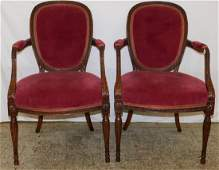 Pair upholstered carved wood French arm chairs