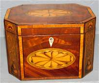 Inlaid fruitwood octagonal tea caddy
