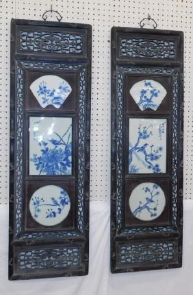 Pr Oriental plaques w/ carved teakwood frames.