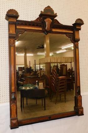 Victorian walnut over mantle mirror.