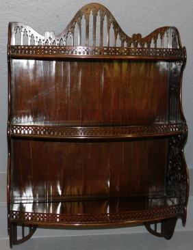 Mahogany Chippendale hanging gallery shelf.