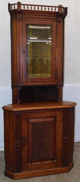 Walnut Victorian glass front corner cupboard.