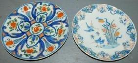 "2 early Delft plates. 9"" dia."