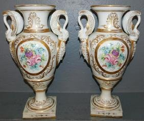 Pair of Old Paris vases with gilt swan handles.