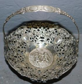 .800 Continental silver figural reticulated basket.