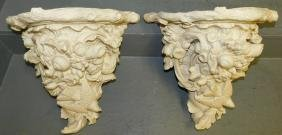 Pair of ornate ceramic wall brackets.