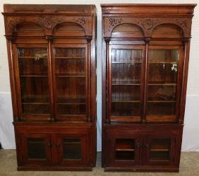 2 carved glass door oak bookcase cabinets.