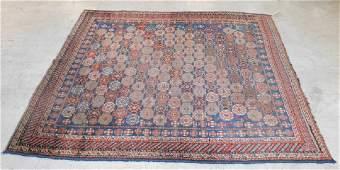 "8'3"" x 6'2"" antique Persian tribal rug"