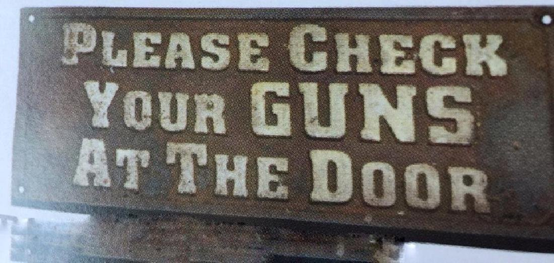 "CHECK YOUR GUNS AT THE DOOR CAST IRON SIGN - 7.5"" X"