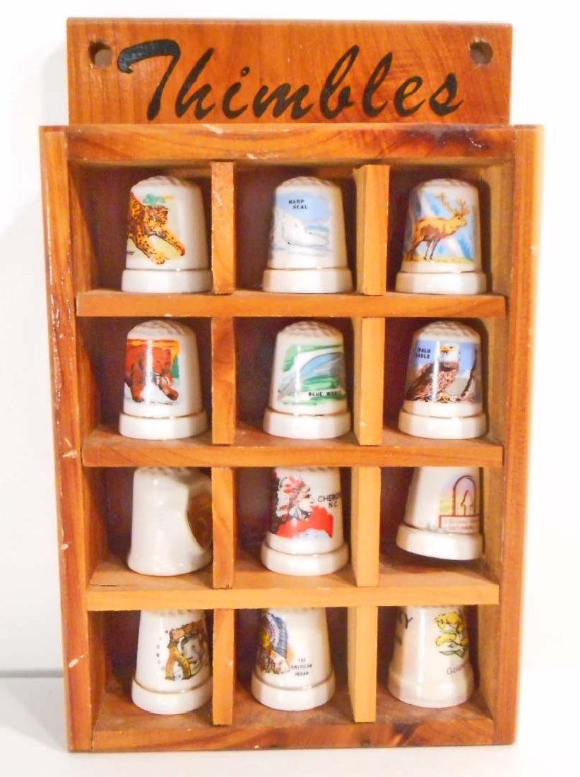 LOT OF 12 VINTAGE PORCELAIN THIMBLES IN WOODEN DISPLAY