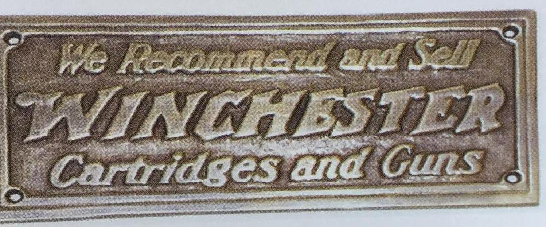 "WINCHESTER BRASS STORE PLAQUE - 7"" X 3"""