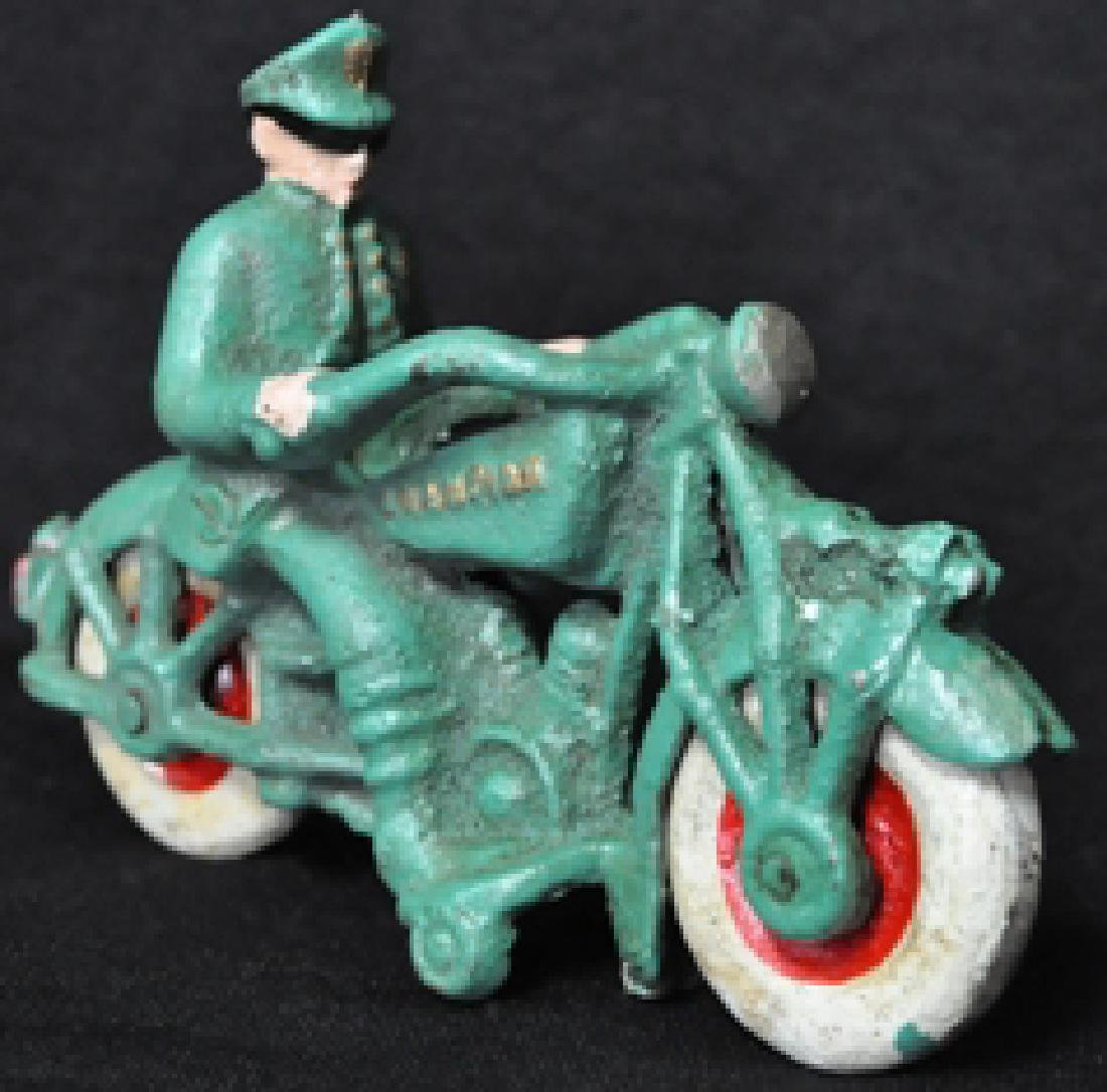 GREEN MOTORCYCLE W/ MAN CAST IRON TOY
