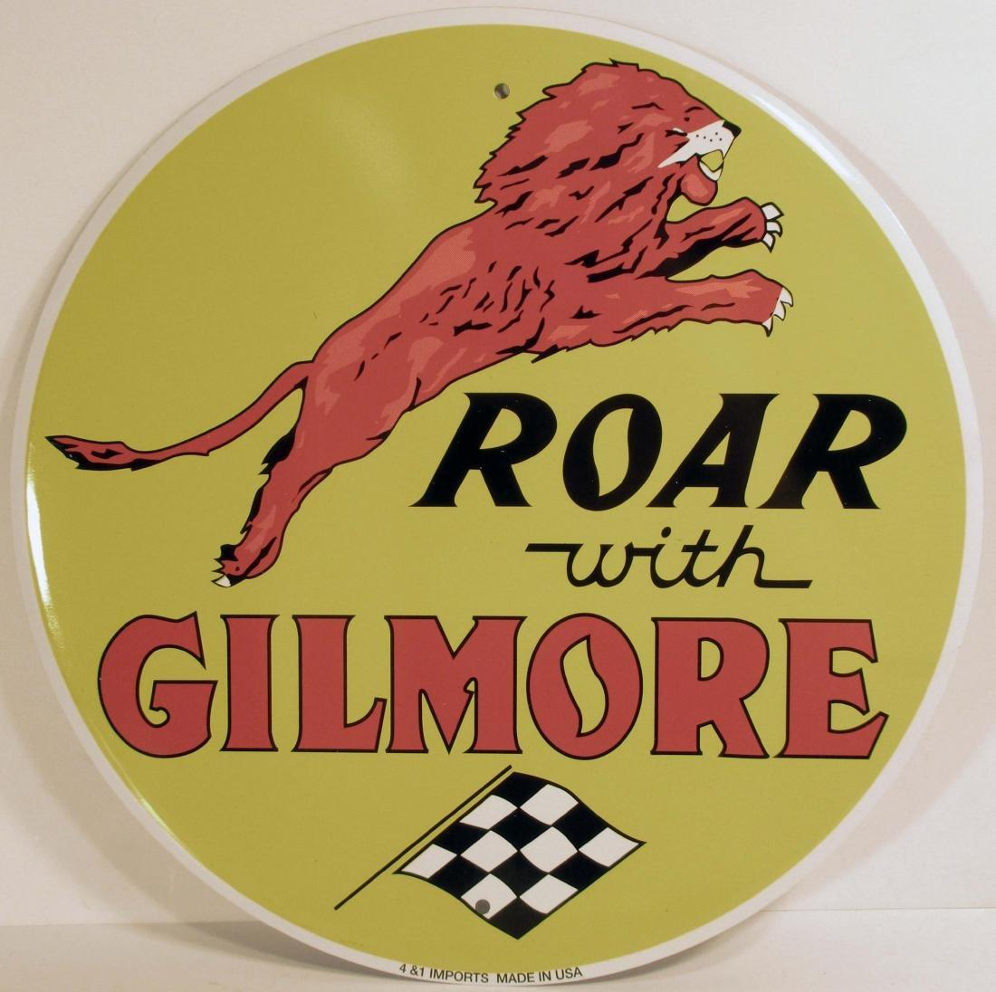 "METAL ROAR W/ GILMORE ROUND ADVERTISING SIGN - 12"" DIAM"