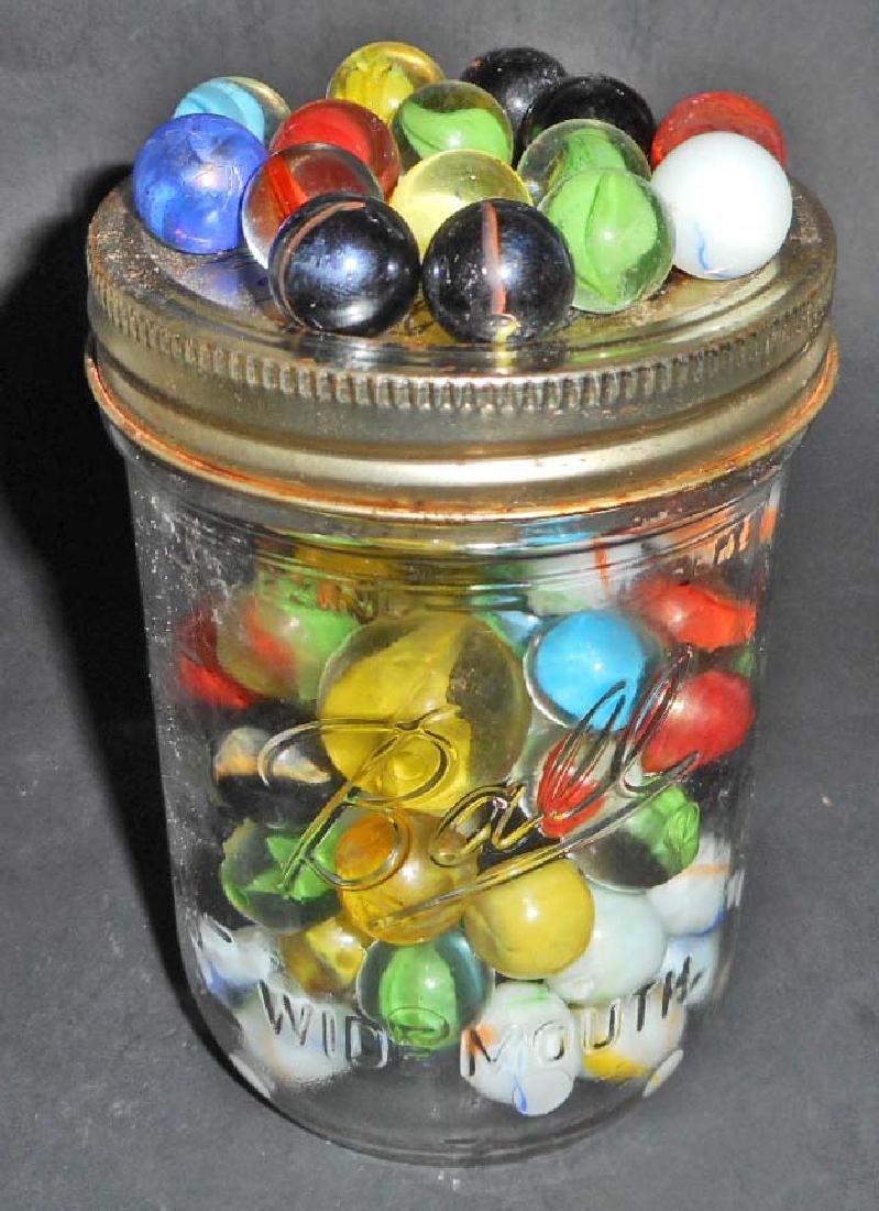 JAR FULL OF VINTAGE MARBLES