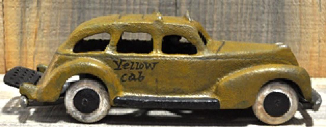CAST IRON YELLOW CAB TAXI TOY