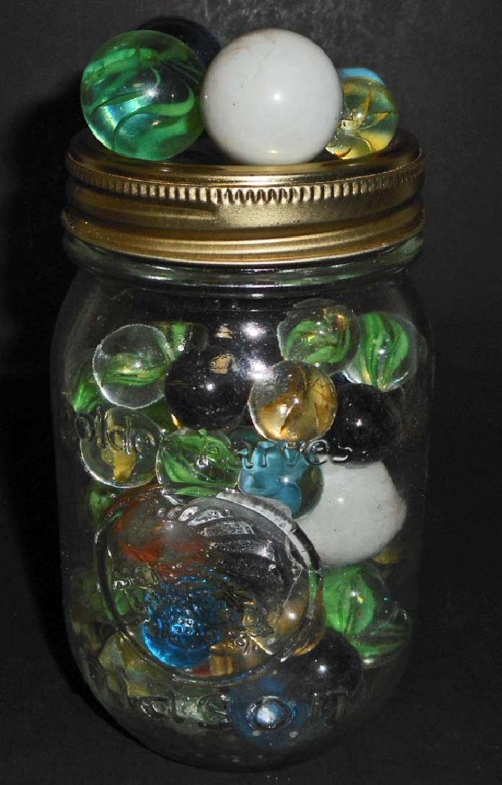 JAR OF VINTAGE MARBLES INCL. SHOOTERS