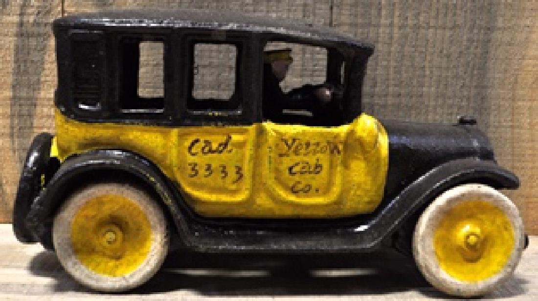 YELLOW TAXI CAB CAST IRON TOY