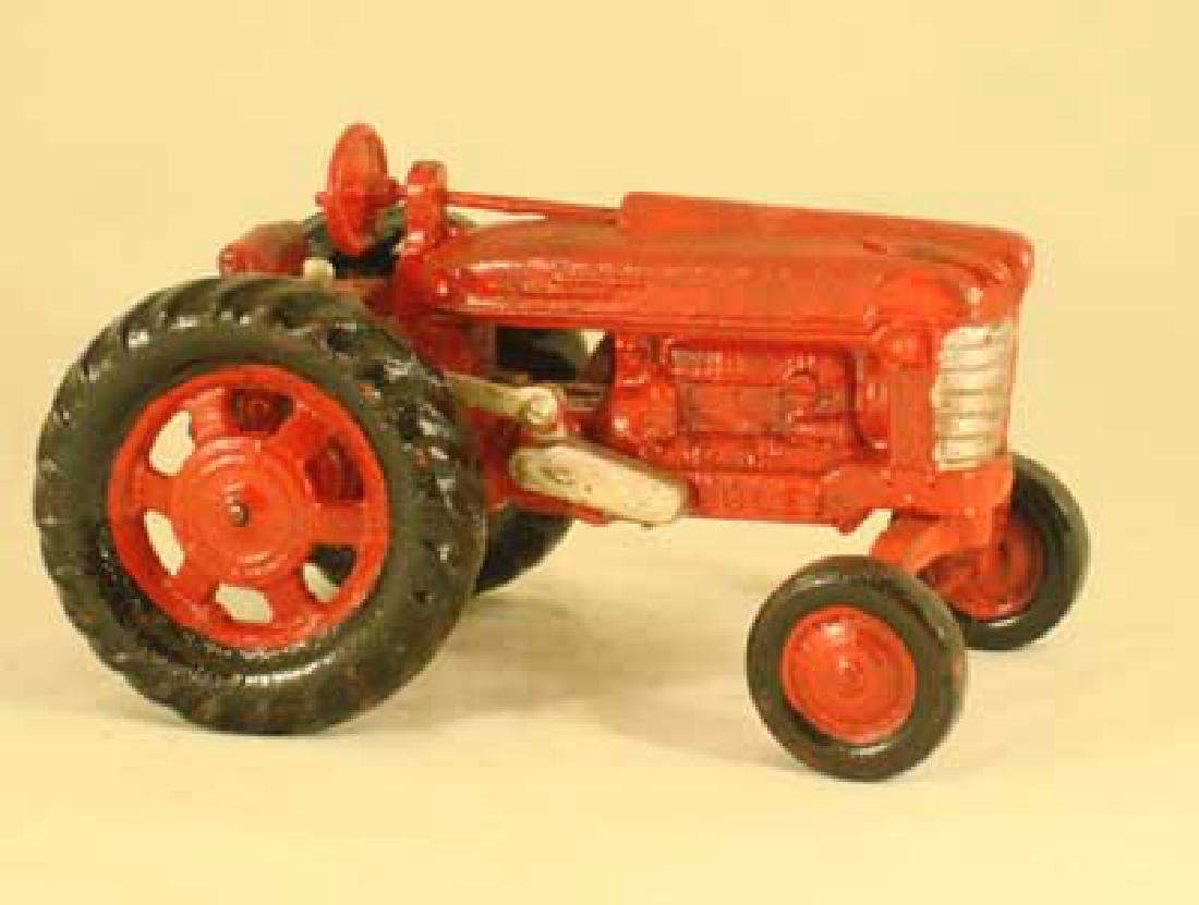 RED CAST IRON TRACTOR TOY