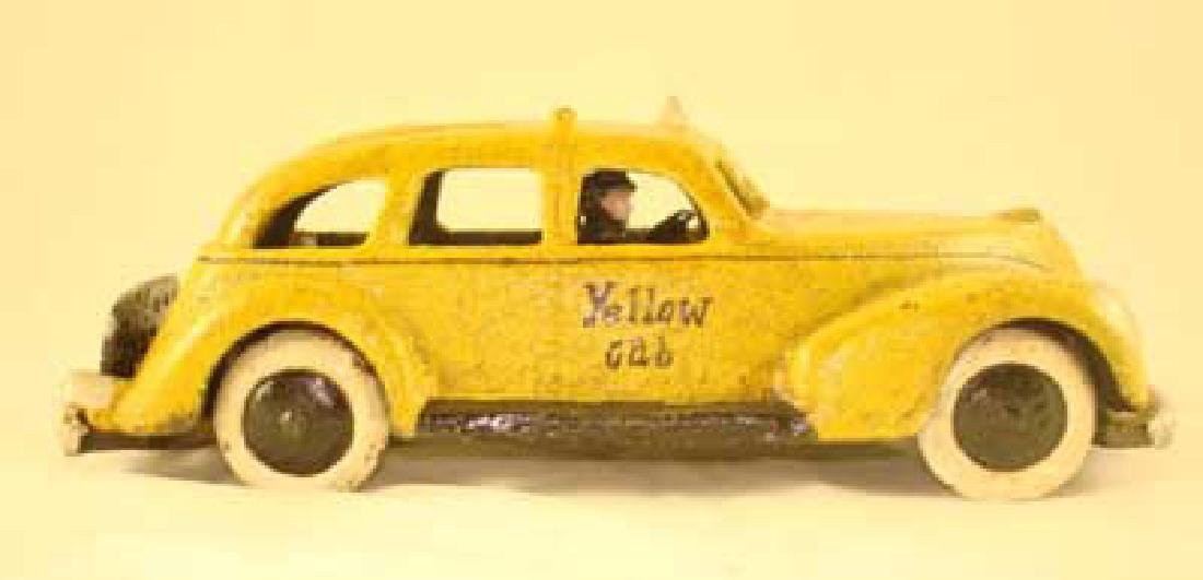 CAST IRON YELLOW TAXI CAB TOY