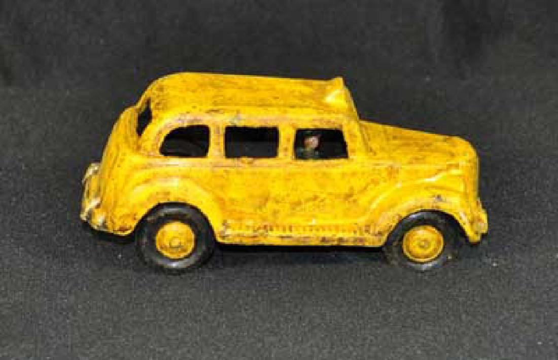 CAST IRON TAXI CAB TOY