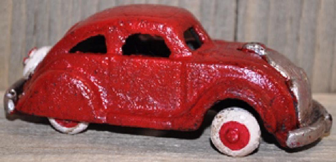 CAST IRON RED CAR TOY