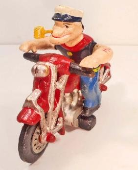 CAST IRON POPEYE ON MOTORCYCLE TOY