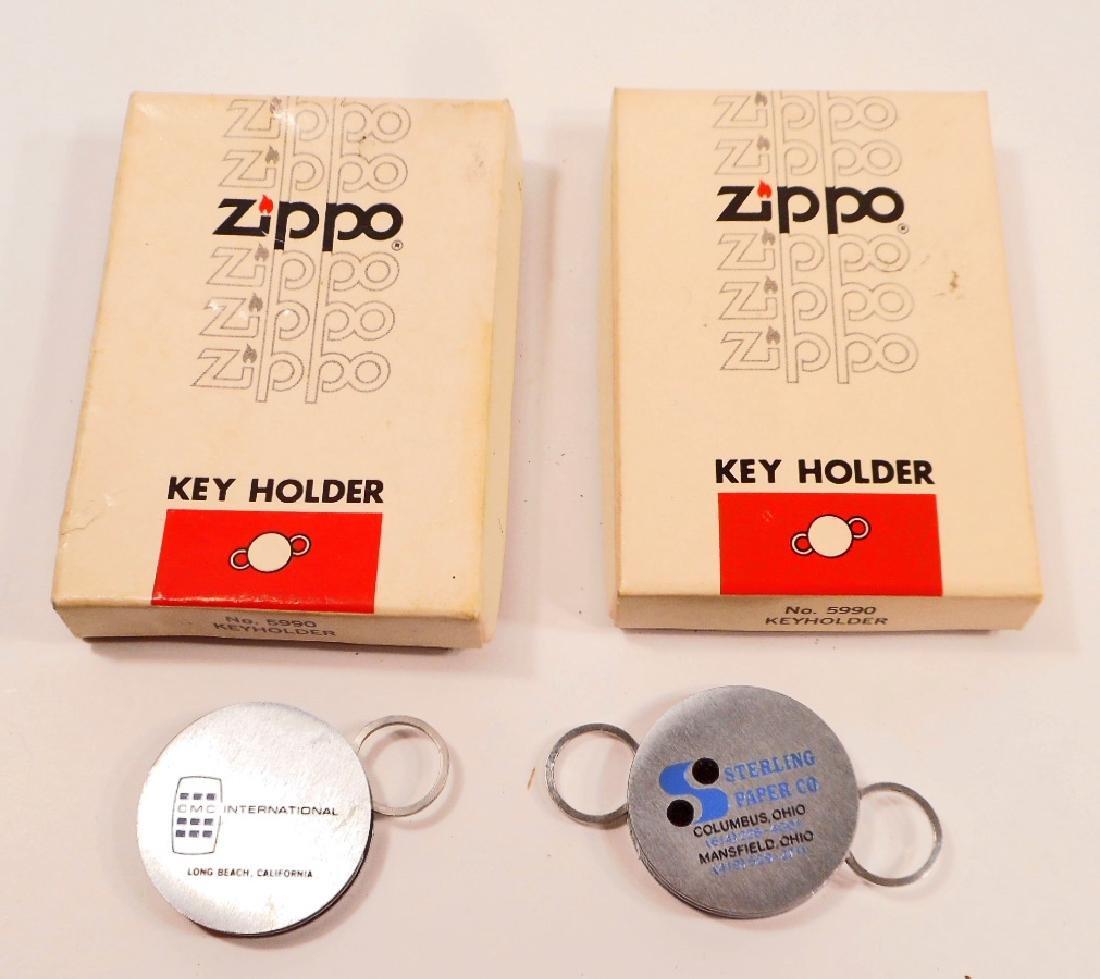 LOT OF 2 VINTAGE ZIPPO ADVERTISING KEY HOLDERS