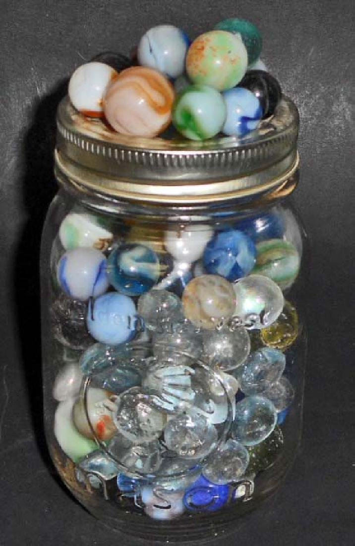 JAR OF VINTAGE MARBLES - INCL. SHOOTERS
