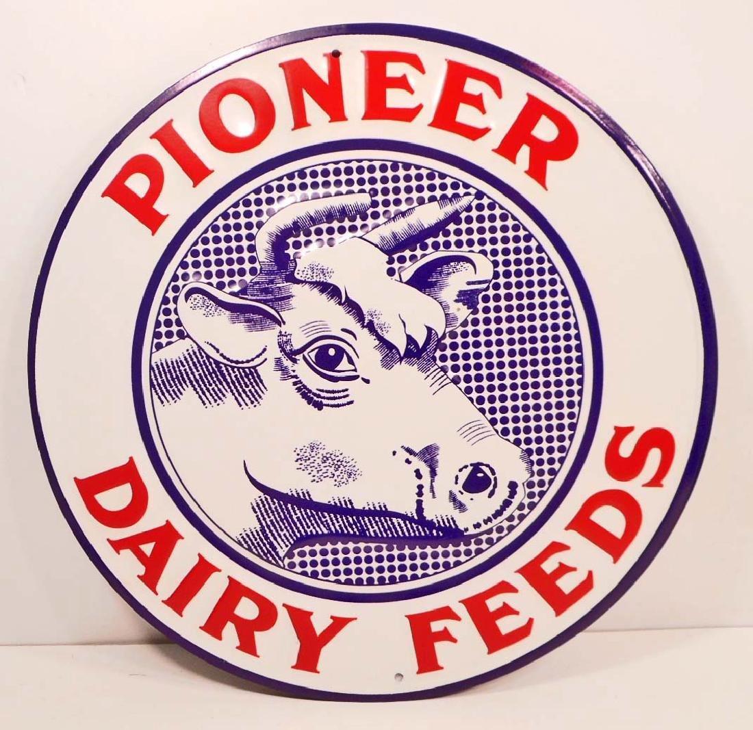 PIONEER DAIRY FEED EMBOSSED ROUND METAL SIGN