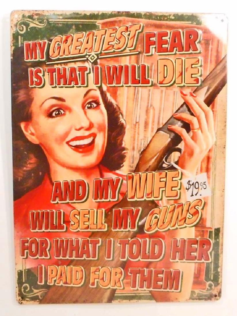 WIFE SELLING GUNS FUNNY EMBOSSED METAL SIGN