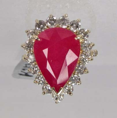 315: 14K GOLD LADIES RUBY AND DIAMOND RING - SIZE 7.5 -