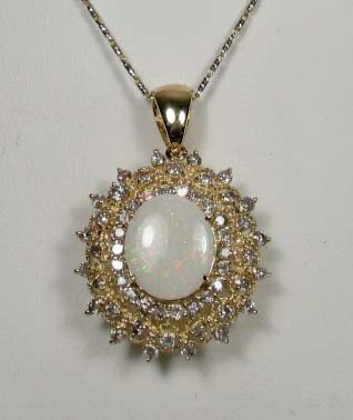 321: 14K GOLD LADIES OPAL AND DIAMOND PENDANT W/ CHAIN