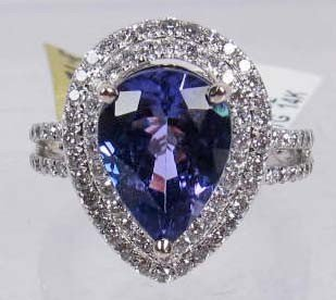 91: 14K WHITE GOLD LADIES TANZANITE AND DIAMOND RING -