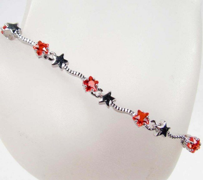 8: WHITE GOLD PLATED, RUBY BRACELET - 28.9 CTW