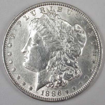 17: 1886-P MORGAN SILVER DOLLAR