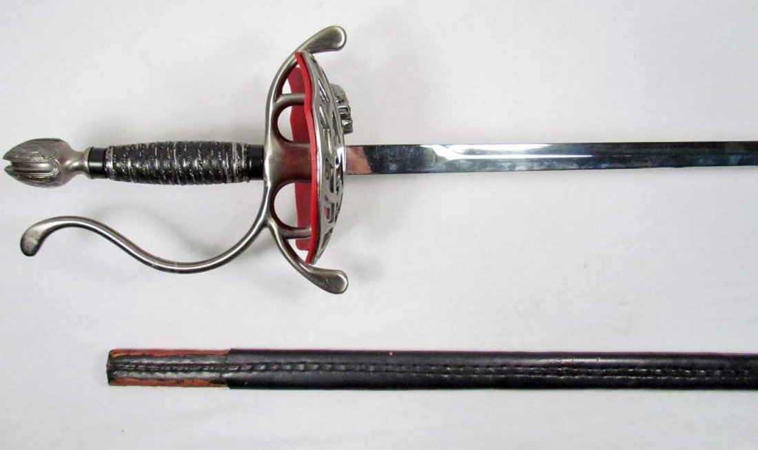 10: STAINLESS STEEL SWORD W/ SCABBARD AND SKULL ON KNUC