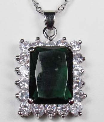 19: WHITE GOLD PLATED EMERALD AND WHITE TOPAZ PENDANT W