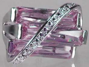 84: STERLING SILVER PINK SAPPHIRE AND WHITE TOPAZ RING