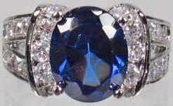 21: 760 - WHITE GOLD PLATED SAPPHIRE & TOPAZ RING -SZ.