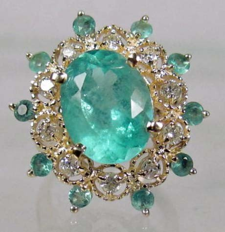 4: 14K GOLD LADIES EMERALD AND DIAMOND RING - SIZE 7
