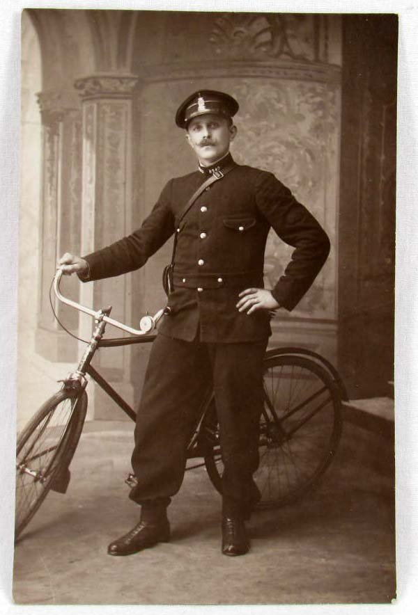 11: VINTAGE RPPC REAL PHOTO POSTCARD OF A POLICE OFFICE