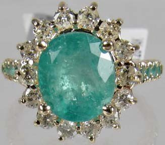 96: 14K GOLD EMERALD AND DIAMOND LADIES RING - SIZE 7.5