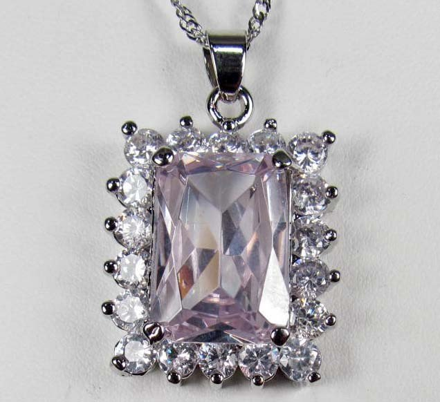 8: 2989 - WHITE GOLD PLATED TOPAZ PENDANT W/ CHAIN - 68