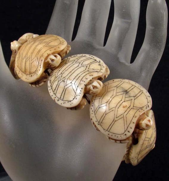 16: 3416 - HAND CARVED BONE BRACELET - TURTLES