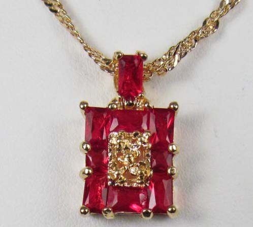 22: 3019 - 14K GOLD PLATED RUBY PENDANT W/ CHAIN - 31.1