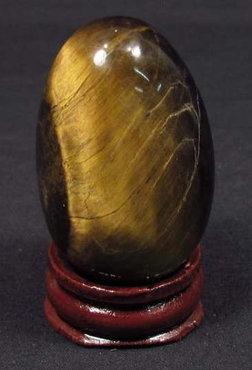 21: 299 CT NATURAL TIGER'S EYE CARVED EGG W/ STAND